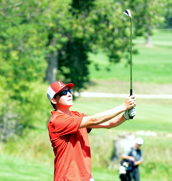 Loveland's Jake Trolliet watches his approach shot during the Walt Clark Invitational on Wednesday at the Olde Course in Loveland. (Mike Brohard/Loveland Reporter-Herald)