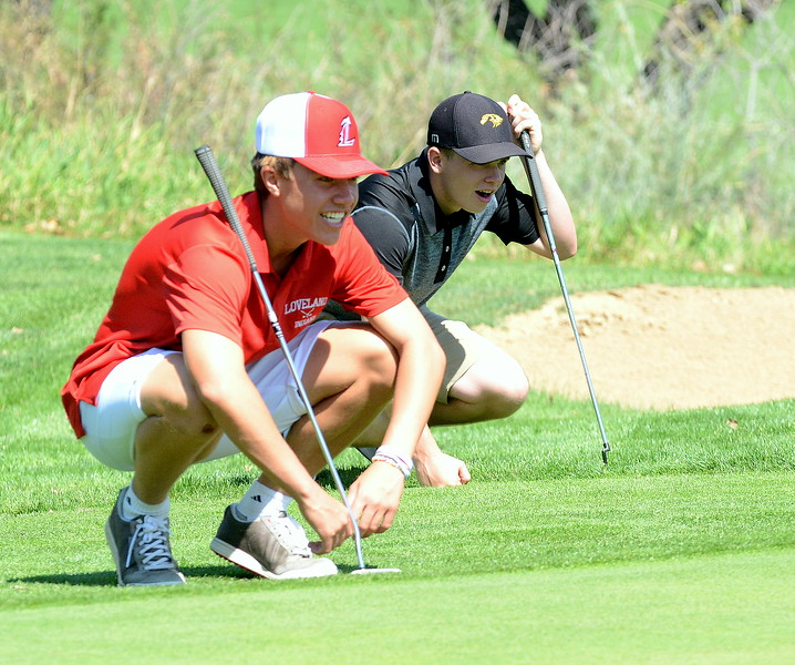 Loveland's Jaxon Cabrera (left) and Thompson Valley's Whit Hewett share a laugh as they line up their putts during the Walt Clark Invitational on Wednesday at the Olde Course in Loveland. (Mike Brohard/Loveland Reporter-Herald)