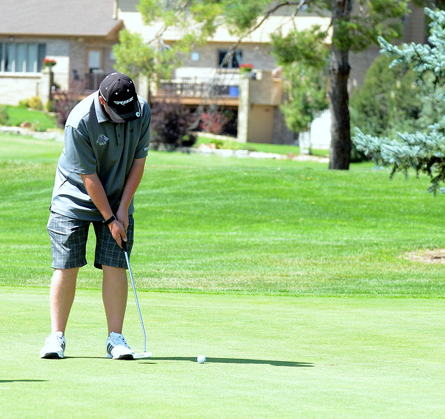 Mountain View's Jeremy Atwood slides his putt into the hole during the Walt Clark Invitational on Wednesday at the Olde Course in Loveland. (Mike Brohard/Loveland Reporter-Herald)