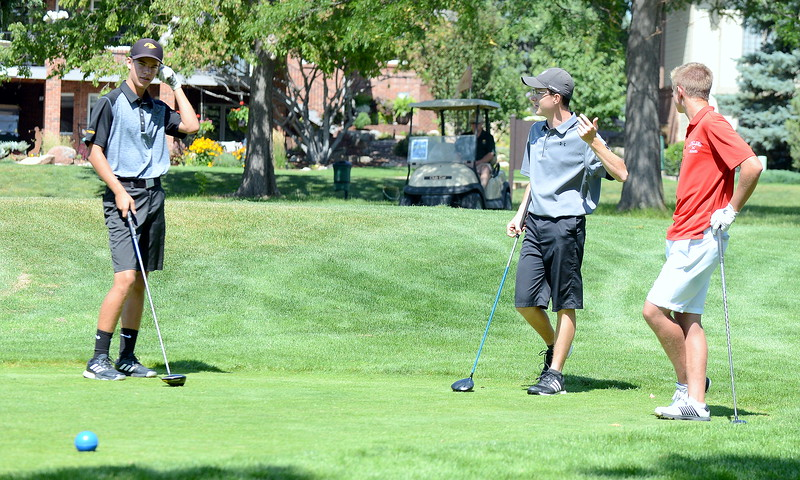 Thompson Valley's Mason Magley, Mountain View's Gavin McWhorter and Loveland's Blaine Tucker (left to right) talk on the tee box as they wait for the next group to move forward during the Walt Clark Invitational on Wednesday at the Olde Course in Loveland. (Mike Brohard/Loveland Reporter-Herald)