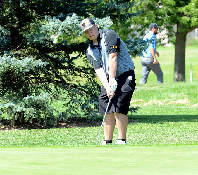 Thompson Valley's Dylan Malone chips on to the green during the Walt Clark Invitational on Wednesday at the Olde Course in Loveland. (Mike Brohard/Loveland Reporter-Herald)
