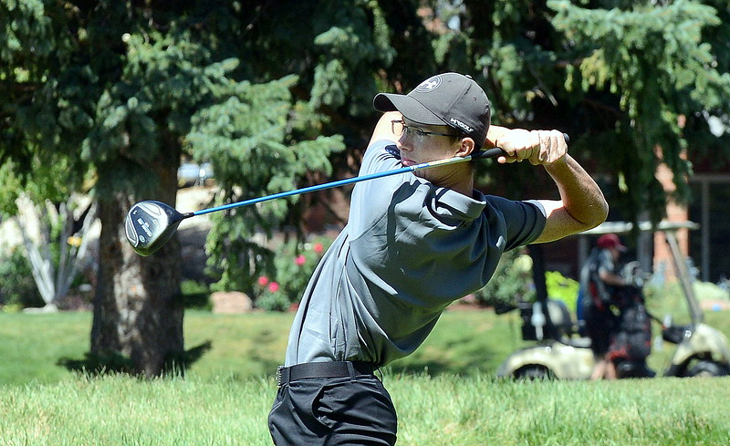 Gavin McWhorter of Mountain View poses at the end of his follow through as he watches his drive during the Walt Clark Invitational on Wednesday at the Olde Course in Loveland. (Mike Brohard/Loveland Reporter-Herald)