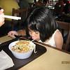 Heather eating Tempura Shrimp Udon