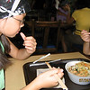 Evelyn eating Tempura Shrimp Udon