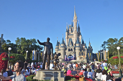 View of Cinderella's Castle with the Walt and Mickey statue in the foreground.