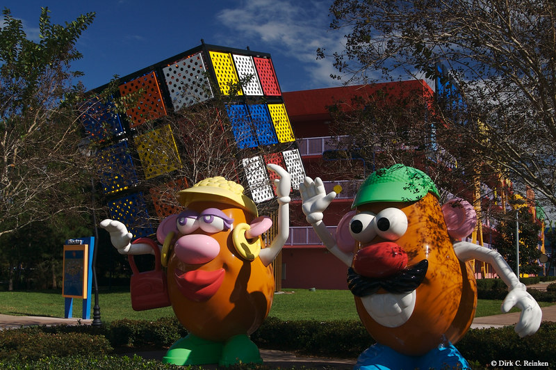 Mr. & Mrs. Potato Head in fron of the '80s building at Pop  Century