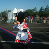 Mickey and Minnie cheering on people as they cross the finish line!
