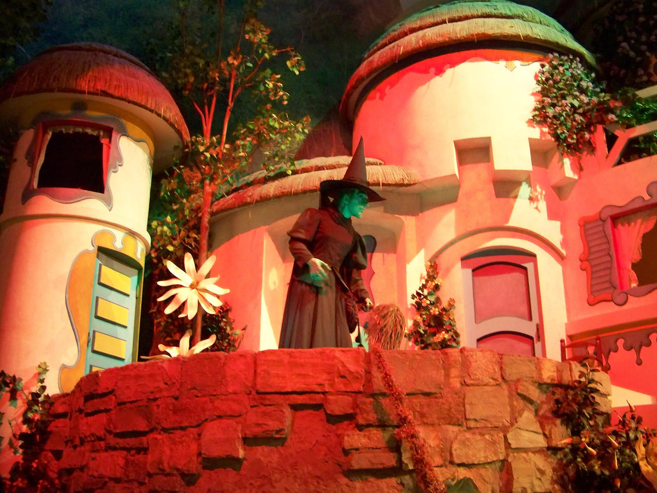 Then there's a puff of orange smoke, and the Wicked Witch of the West suddenly appears in Munchkinland.  Don't be scared!<br /> [Disney's Hollywood Studios - Great Movie Ride - The Wizard of Oz]