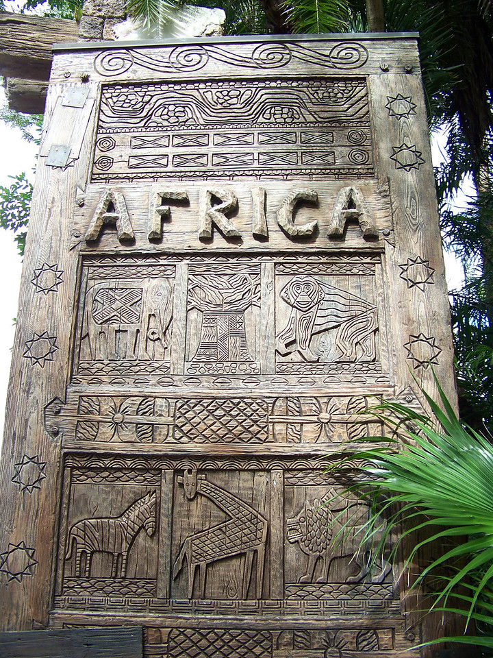 These elaborately-carved doors were at the entrance to the park's Africa section.  We went on the Kilimanjaro Safari ride here, which includes lots of bumpy roads.  Since I was worried the bumps might retrigger my queasiness, I didn't try to take any pictures of the numerous animals we saw.<br /> By the way, I first went on this ride in the fall of 2000, and in the spring of 2002 I did the real thing in Kenya.  I can attest that Disney really did a terrific job of condensing the entire safari experience down to a 25-minute ride.<br /> [Disney's Animal Kingdom]