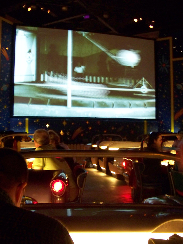 """The Sci-Fi Dine-In Theater is very fun.  The tables are shaped like 1950s cars, and are """"parked"""" facing a movie screen, just like a drive-in theater.  There's even a speaker on a pole next to your car!<br /> [Disney's Hollywood Studios]"""