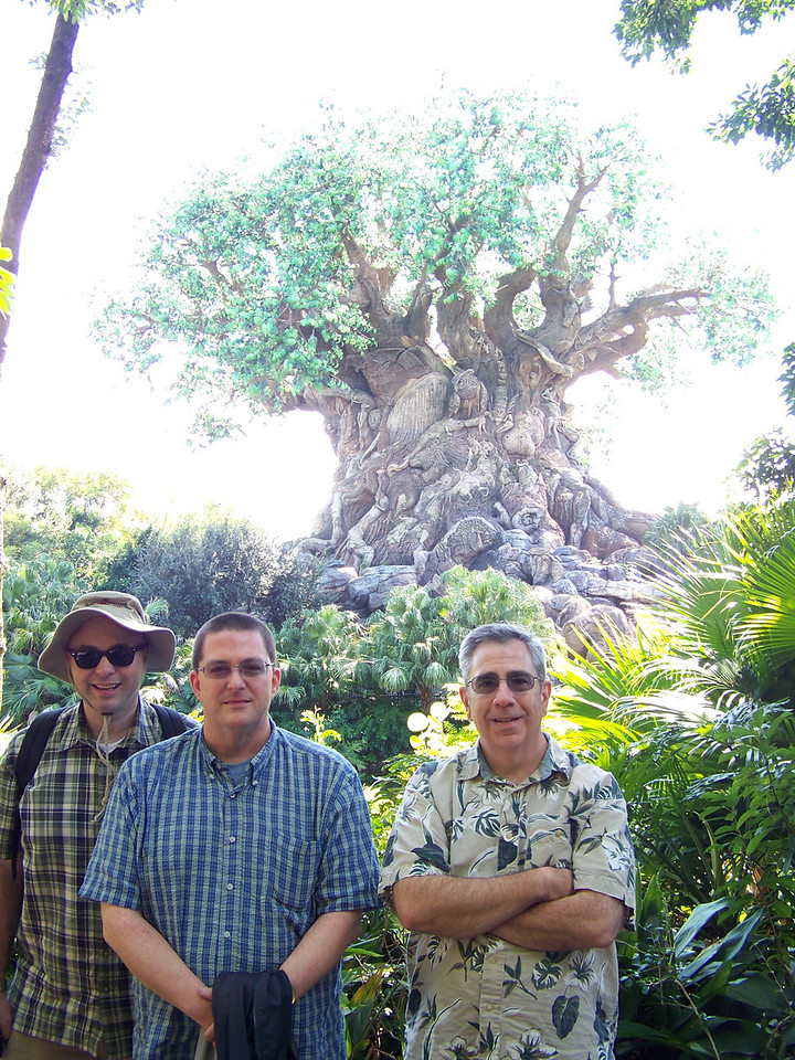 Pat, Jeff and Dave pose with the symbol of the park, which is called the Tree of Life.<br /> I took this shot, with the camera's exposure focused on the people.<br /> [Disney's Animal Kingdom]