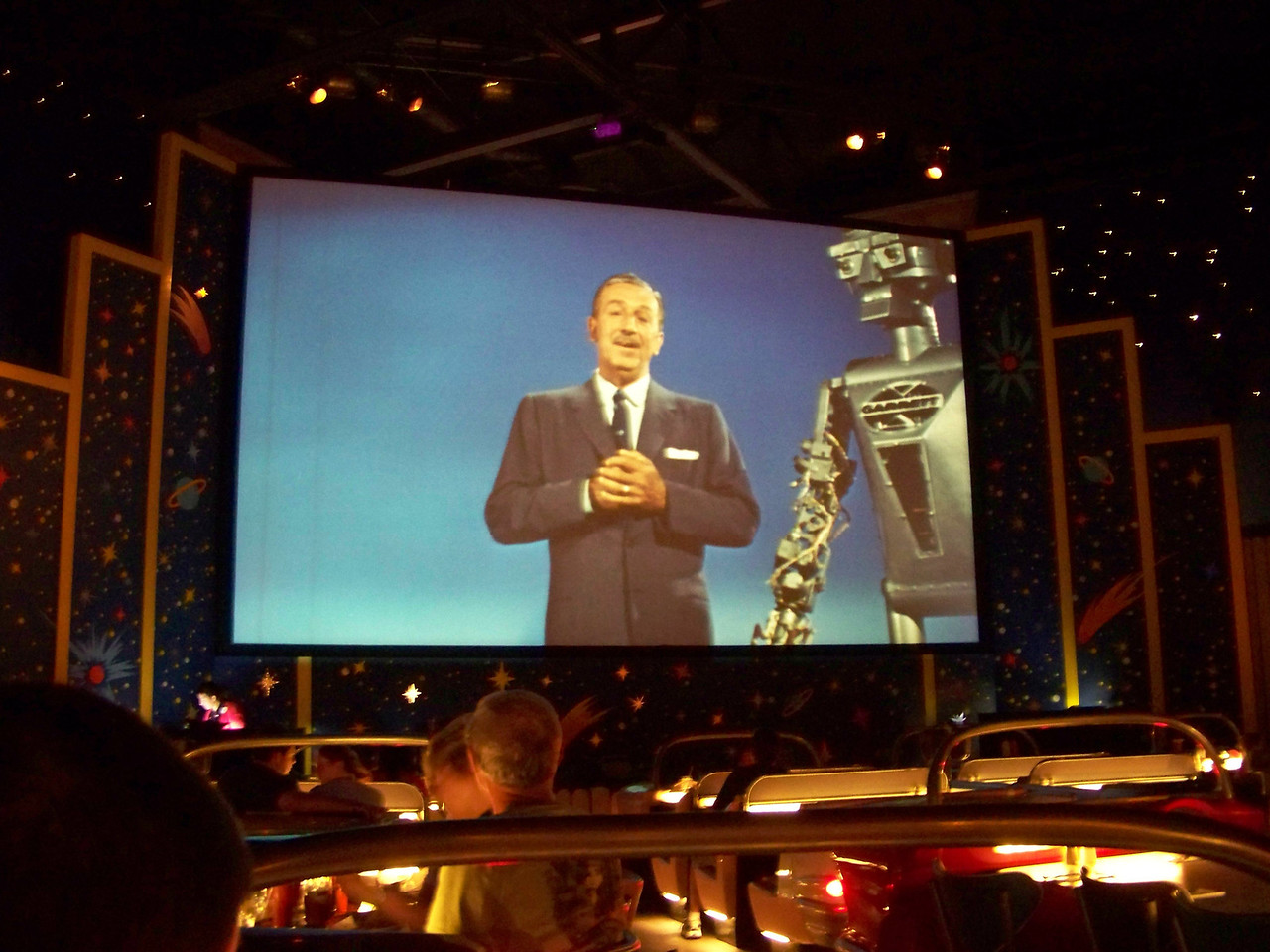 """The Sci-Fi Dine-In Theater's movie screen shows a loop of film clips from the 1950s.  There's lots of trailers for cheesy UFO and monster movies, clips from short subjects about sci-fi things (""""By 1985, everyone will have their own jetpack!""""), and even some Disney clips, such as the one seen here with Walt talking about robots.  It's very entertaining, but we wished the loop was a bit longer, as we saw it play all the way through and then repeat about half of it while we were there.  Overall, this is a really fun restaurant, and I had a great time there!<br /> [Disney's Hollywood Studios]"""