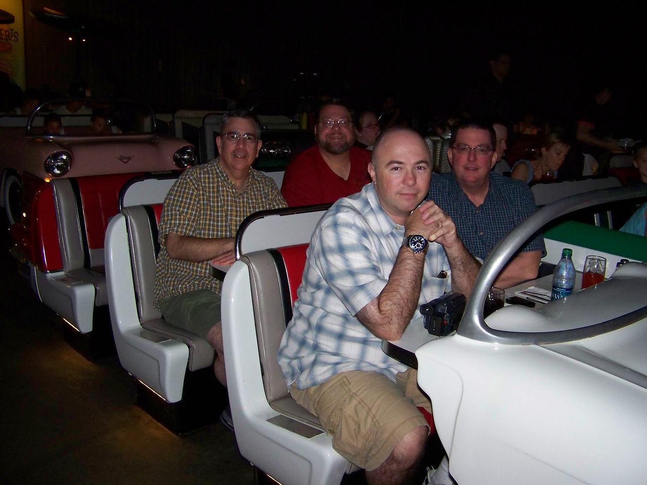 Our waitress took this shot of all four of us in the car at the Sci-Fi Dine-In Theater.  Pat and Jeff are in the front row, with Dave and Jon in the middle row.  As you can see, each car can seat up to six, but the third row in our car remained empty while we were there.<br /> [Disney's Hollywood Studios]