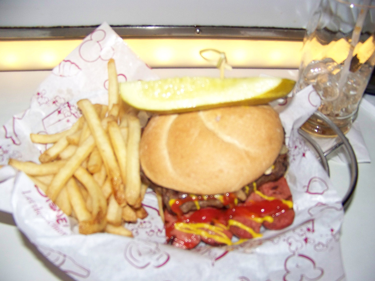 I had the All-American Picnic Burger at the Sci-Fi Dine-In Theater.  In addition to a hamburger patty,  it also includes two hotdogs that are split open lengthwise and grilled.  It tasted good, but there was too much meat for the bun, and it quickly fell apart.  I wound up eating the hotdogs separately with a fork.  I also had a delicious shake for dessert.<br /> [Disney's Hollywood Studios]