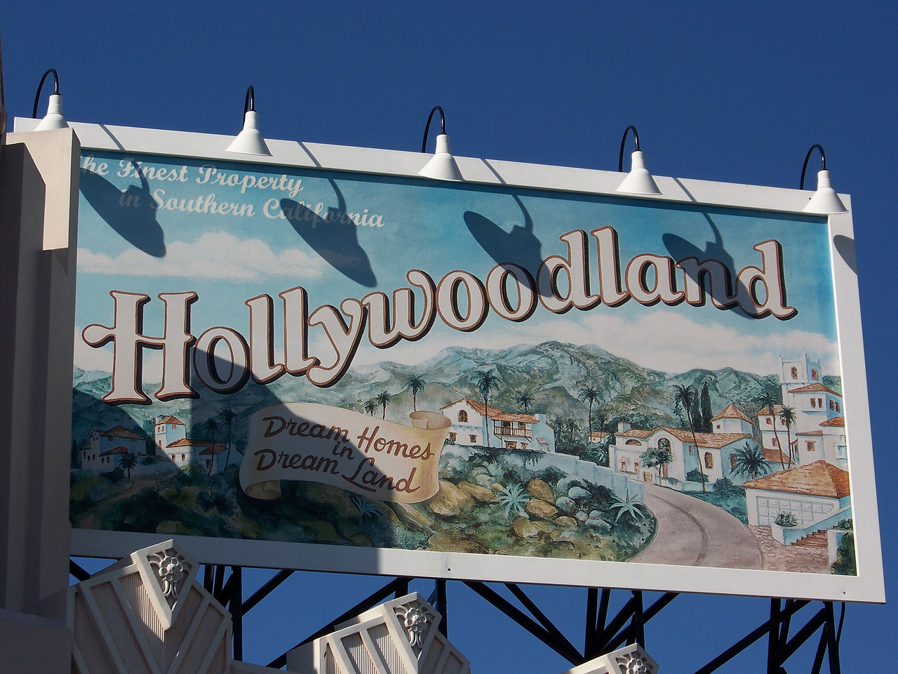 """Billboard on Hollywood Blvd.  The original Hollywood sign (which indeed said """"Hollywoodland"""") was erected as a promotional tool for real estate developers in the early 1920s.  So this sign helps to establish the era being protrayed in this part of the park.<br /> [Disney's Hollywood Studios]"""