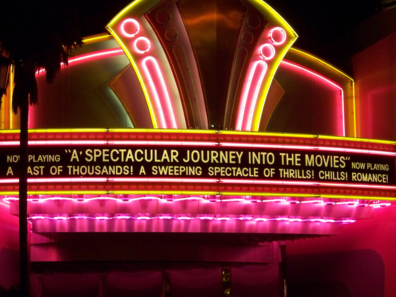 Now we're sitting in our ride vehicle, about to begin.  The doors under this marquee open, and we start slowly rolling through scenes from Hollywood history.  Lights!  Camera!  Action!<br /> [Disney's Hollywood Studios - Great Movie Ride]