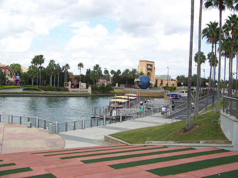 After parking the car in a huge garage and walking through the shops and restaurants of Universal CityWalk, you come to this small lake.  The two theme parks here are on either side of the lake.  To the right, you can see the entrance to the original Universal Studios Florida (we'll go there later in the day).<br /> [Universal Orlando]