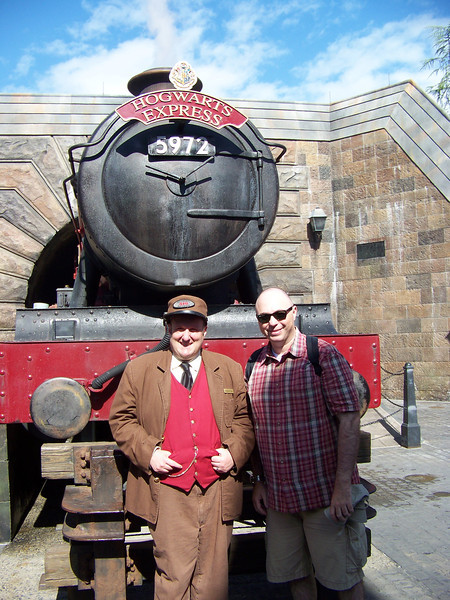 Later in the day, the conductor of the Hogwarts Express posed for a picture with Pat.<br /> [Universal Islands of Adventure - Wizarding World of Harry Potter]