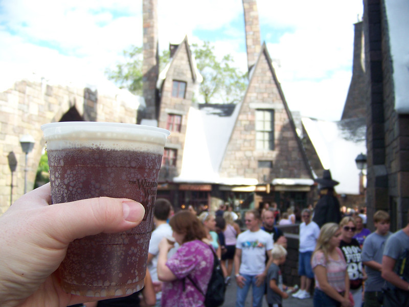 Cheers, Hogsmeade!  Butterbeer tastes similar to cream soda, but then they float a frothy, creamy foam on top of it which has a butterscotch flavor.<br /> [Universal Islands of Adventure - Wizarding World of Harry Potter]