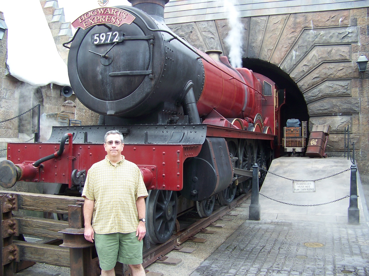 Dave poses with the Hogwarts Express.  The train would occasionally chuff and let off steam, but it's not a ride--just a photo op.<br /> [Universal Islands of Adventure - Wizarding World of Harry Potter]