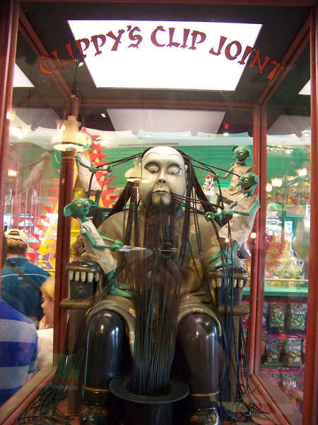 Inside Honeydukes is a glass case called Clippy's Clip Joint.  This mechanical man's hair is actually licorice, which the mechanical house-elves are trimming.  Care for a bag of the clippings?<br /> [Universal Islands of Adventure - Wizarding World of Harry Potter]