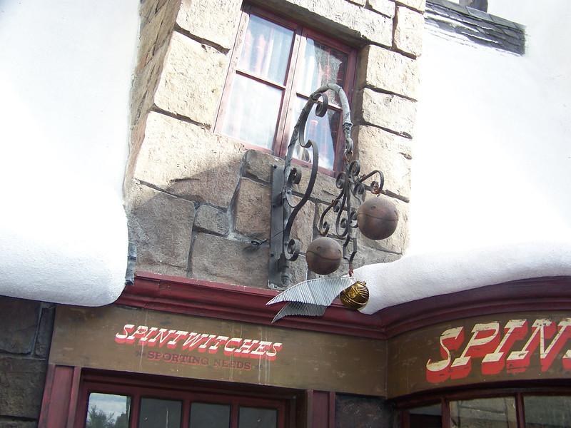 "Several ""shops"" in Hogsmeade were just facades you could look into, but not actually enter.  Such was the case with Spintwitches Sporting Needs.  Their sign featured a couple of quaffles and an oversized golden snitch.<br /> [Universal Islands of Adventure - Wizarding World of Harry Potter]"