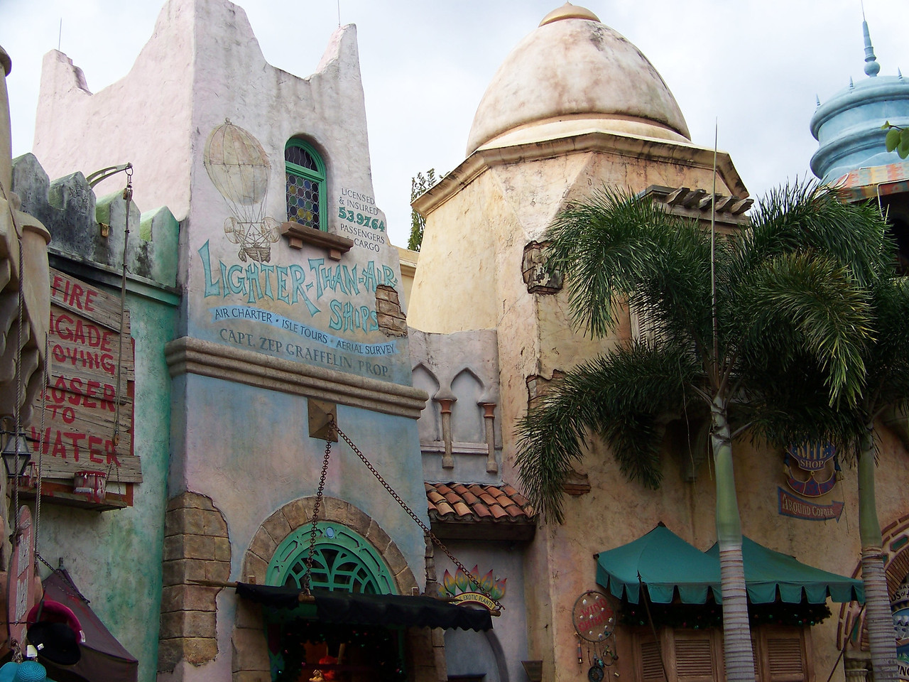 "The Port of Entry is filled with shops and guest services.  It features ""fantasy exotic"" architecture that isn't meant to represent any real place or time.<br /> [Universal Islands of Adventure]"