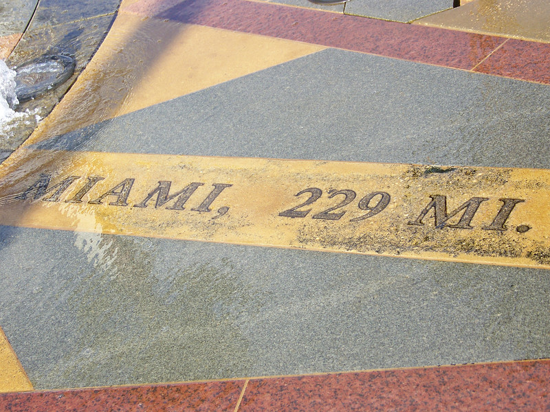 The fountain's compass rose showed us that we were 229 miles from Miami.<br /> [Celebration, Florida]