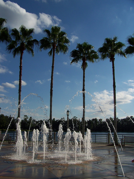 The fountain, with the lake seen beyond it.  While there, we watched several little kids who were having fun running through the fountain and trying to avoid the changing jets of water.<br /> [Celebration, Florida]