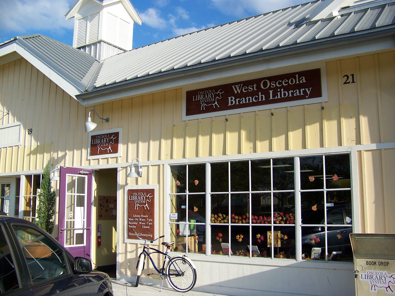 "We got back in the car and drove over to their small library, which is a branch of the <b><a target=""_new"" href=""http://www.myosceolalibrary.org/"">Osceola Library System.</a></b>  It's a storefront library in a shopping center.  I didn't take any pictures inside. [Celebration, Florida]"