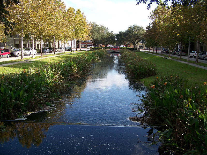 Extending away from the town center (which we'll explore in a moment) is the well-named Water Street.  The two lanes of Water Street are separated by this little creek which runs into a large lake on the other side of the town center.<br /> [Celebration, Florida]