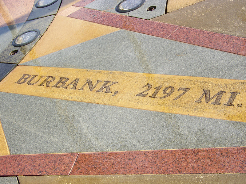 The fountain's compass rose showed we were also 2197 miles from Burbank, CA.  Why Burbank?  That's where the Disney company's headquarters are!<br /> [Celebration, Florida]