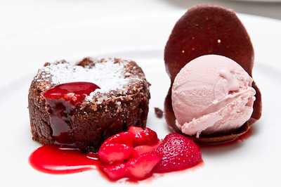 Valrhona Chocolate Cake  Warm Chocolate Cake with Molten Center, Macerated California Strawberries and Grand Marnier