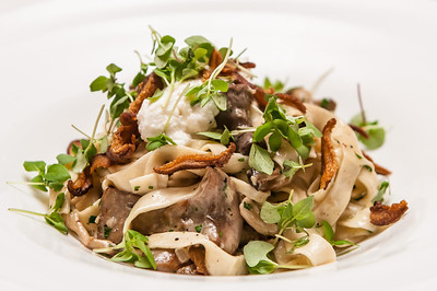 Handmade Fettuccine with Sautéed Chanterelle and Summer Mushrooms, fresh Buttermilk Ricotta, Tiny Basil