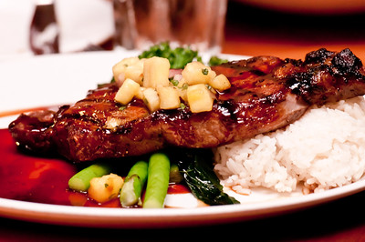 Teriyaki-style New York Strip - sirloin strip grilled with pineapple teriyaki glaze served with mashed Yukon gold potatoes and stir-fried broccolini