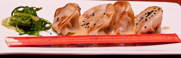Pot Stickers - wok-seared duck dumplings with creamy ginger soy sauce