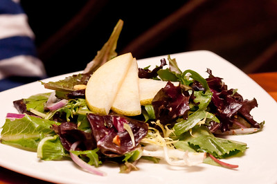 Kona Salad - Mixed greens, Maytag blue cheese, fresh fruit, red onions, and smoked almonds with a citrus vinaigrette