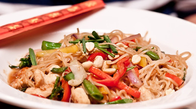 Pan Asian Noodles - Asian egg noodles with sliced chicken, pineapple, seasonal vegetables, and a housemade sweet and sour sauce