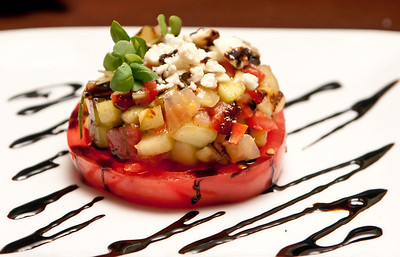 Tomato Stack with Caramelized Onions, Cucumbers, Crumbled Blue Cheese, and Yuzu Vinaigrette *