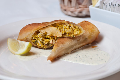 SEAFOOD BASTILLA Baked layers of thin pastry stuffed with shermoula sauce, grouper, shrimp and mushrooms