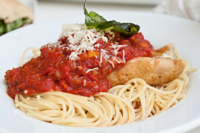 Chicken Parmigiana Lightly Breaded Chicken Breast with Marinara Sauce topped with Melted Mozzarella over Spaghetti