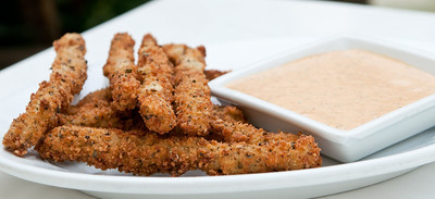 Zucchini Fries Breaded seasoned Zucchini with creamy  Sun-dried Tomato Dressing for dipping *