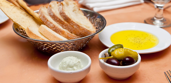 Bread, peppers, olives and ricotta butter