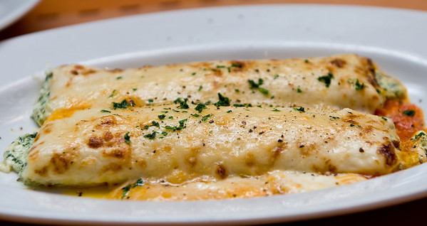 Cannelloni al Forno - baked with spinach, ricotta, bechamel and parmesan cheese