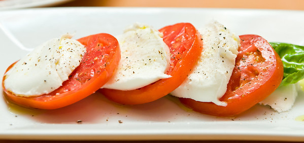 "Fresh ""Bufala"" Mozzarella - vine ripened tomatoes, basil and Tuscan olive oil"