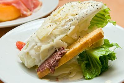 Caesar Salad - romaine, olive crostini, pomodorini, and shaved parmesan