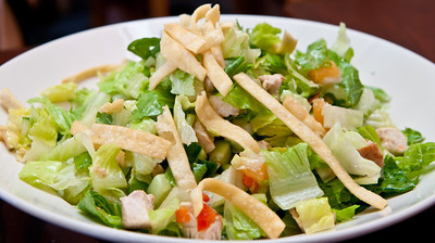 Pollo - chopped romaine, chicken, cucumber, peppers, toasted almonds, canteloupe, honey-citrus vinaigrette