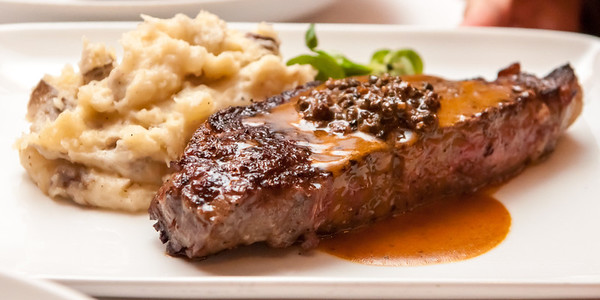 New York Strip Steak Mashed Potatoes, and peppercorn bandy sauce