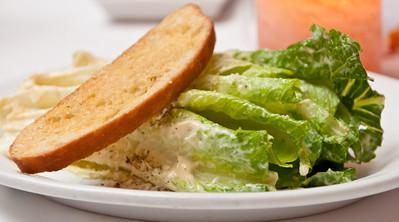 Caesar Salad Crisp Romaine, Aged Parmigiano Reggiano, and Ciabatta Crouton