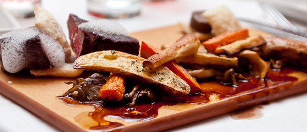 Deconstructed Beef Wellington 8-oz. Filet, Trio of Wild Mushroom Duxelles, Puff Pastry, Parsnips, Potatoes, Carrots, and Red Wine Sauce